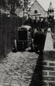 "BW192-3-2-2-28-90: ""Group of men and a towpath haulage tractor on the Regent's Canal"" c1920"