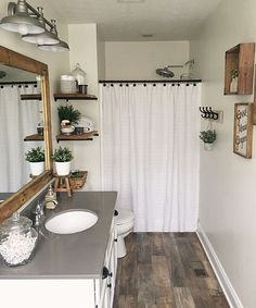 You don't have to completely gut a room to redo it. @our_backwoods_farm transformed her bathroom to have farmhouse style by repainting and…