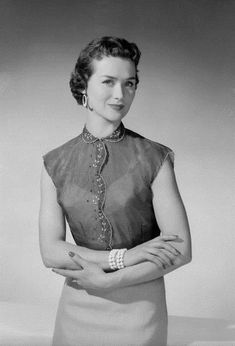 A lovely short-sleeved sheer blouse with embroidery at the collar and seams, January 1954. #vintage #1950s #fashion #blouses