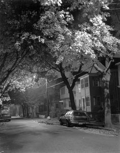 Medford, Mass., circa 1977. Marion Street about 2 a.m. around the corner from my house. It was fall and the leaves were just turning over a Pinto wagon with fake wood paneling. I took this for a class at the New England School of Photography. The exposure was about a minute with a 4x5 view camera. The wind hardly moved. It was a truly beautiful timeless moment.