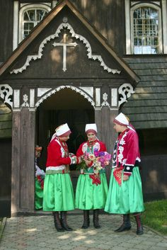 Europe | Portrait of three women wearing traditional clothes, Wilamowice, Silesia, Poland.