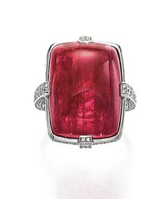 THE 'PIGEON HEART RUBY' RING, CARTIER The cushion-shaped cabochon ruby weighing 31.30 carats, claw-set to a mount accented with brilliant-cut diamonds, size 51, signed Cartier, numbered, French assay and maker's marks, case by Cartier.