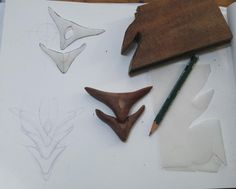 From drawing to carving. The wood is reclaimed African Teak (probably) from the Bristol Wood Recycling Project. In a previous life it was parquet flooring. Work in progress. It will be a necklace.