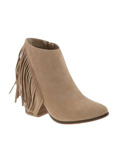 Swap out theclicking of high heels for the melodic thudding of ankle boots with theset-to-trend Desirae Ankle Boots byZOOM. These stone-coloured, pointed toe, fringe boots are the perfect additionto your footwear collection as the season change looms ahead. Pair thesefabulous shoes with rough 'n' tumble denims for a rustic look.Note: these boots are exclusive to Zando! Belt Shop, Fringe Boots, Winter Boots, Season Change, Ankle Boots, High Heels, Footwear, Wedges, Booty