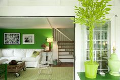 """The view from the front porch into the living room. """"The green paper mache ficus trees keeps things always looking fresh and green,"""" Ted KW says. """"No water required."""""""