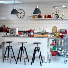 Love:  subway tiles, industrial lighting, shelving, restaurant cart.  Also stools with visible swivel!