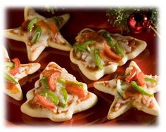 Holiday Pizza Appetizers  - Use you favorite pizza dough and roll  thin. Place on baking sheet and cover with cling film and rest for 20 minutes.  - Preheat oven to 400.F  - Dip cookie cutters in flour and cut desired shapes out of dough.  - Arrange on baking tray and bake for 5 minutes. Remove and allow to cool.  - Top each one with tomato sauce, mozzarella, pepper strips and pepperoni pieces.  - Bake for 6 more minutes or until the cheese is nicely melted.
