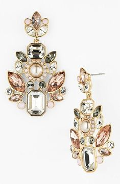 Sparkly pink and gold chandelier earrings for prom.