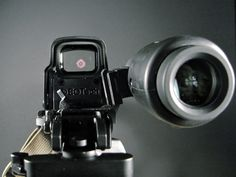EOTECH G23 3X MAGNIFIER in an ARMS flip to side mount EOTECH EXPS 2-0 holographic weapons sight