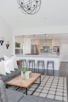 Neat Open Concept Living Room and Kitchen | Open Concept Living Room | Open Concept Kitchen | Shiplap Island | Herringbone Table Top | Neutral Home Décor Ideas | Lovesac Sactional | White and ..