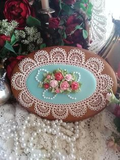 Romantic crocheted lace, pearls, pink roses, pale turquoise oval, by Teri Pringle Wood Rose Cookies, Flower Cookies, Iced Cookies, Easter Cookies, Heart Cookies, Elegant Cookies, Fancy Cookies, Vintage Cookies, Sugar Cookie Royal Icing