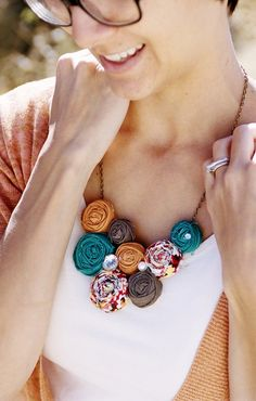 Lee Lynn  -  Teal, Orange, and brown  rosette bib statement necklace. $38.99, via Etsy.