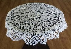 This larger doily is made up of two separate rounds of pineapple designs and makes a stunning table topper.