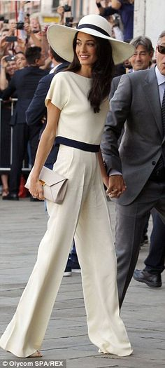 But in the same colours, Amal is simply stunning in a Stella McCartney trouser suit...