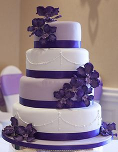 Purple Vanda orchid wedding cake with pearls.....looking at ORCHIDS to get ideas on how to do them on our wedding cake.