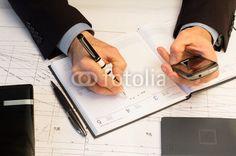 businessman writing business engagement