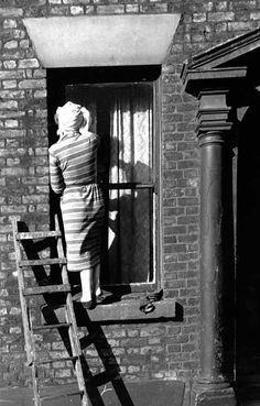 Busy Cleaning Windows,1953. If your windows didn't sparkle the neighbours would tut! If your front step wasn't clean enough to eat your dinner off, the local 'helpful person' would call in to see if you were poorly & needed a helping hand :)