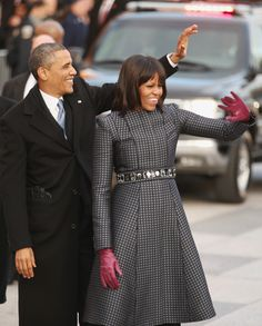 Let's stay together: The Obamas wave to the crowd during the inaugural parade after the swearing-in ceremony Jan. 21, 2013.