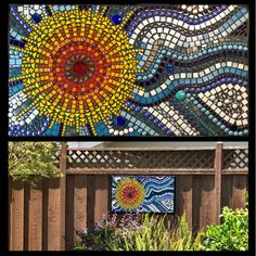 mosaic on fence in garden