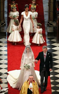 Miss Catherine Middleton is escorted by her father, Michael Middleton. Her sister, Philippa (Pippa) is the maid of honor and she escorts the young bridesmaids and pages up the aisle of Westminster Abbey on April 29, 2011.