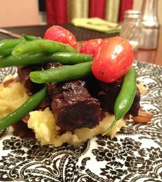 Braised Short Ribs on Garlic Mashed Potatoes with Green Beans and Roasted Tomatoes.