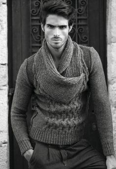 Juan Betancourt. Large knit sweater. The oversized collar would help hide a big belly.