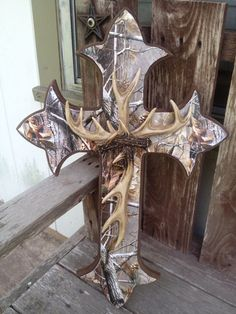 Camo Cross, love with the antlers! So getting this for the living room