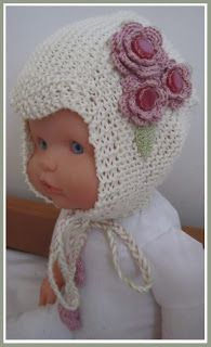 Knitted baby hat with adorable crochet flowers