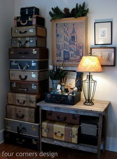 stacked suitcases good for storage whether it's a table or an entire wall.  I'd tie a tag to each handle and write what's inside... Fabric, yarn, snickers, magazines, rubber bands, very small rocks, ammo, a duck...