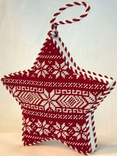 Needlepoint inspired by classic Scandinavian design with this Nordic-inspired Star Ornament. Use charted patterns & 2 colors of thread for a free project Nordic Christmas, Christmas Sewing, Christmas Embroidery, Christmas Cross, Christmas Ornaments, Christmas Decor, Mini Cross Stitch, Cross Stitch Samplers, Cross Stitching