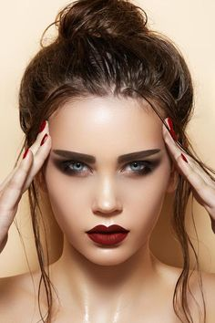 Bold Makeup. Love how defined the lips are. Not a fan of the brows though.