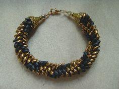 Black and Gold Magatama Kumihimo Bracelet by whitecloverstudios, $35.00