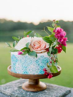 wedding cake with patterns - photo by Dana Fernandez Photography http://ruffledblog.com/mexico-inspired-wedding-ideas-with-bougainvillea