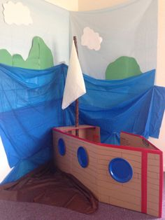 Shipwrecked room. I used tablecloths for the backdrop and for the sail.  I made the boat from cardboard.