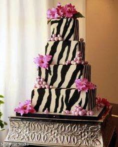 Unusual square, four tier black and white zebra wedding cake design, decorate with handmade pastel pink baubles on alternating corners of each tier, and pink tiger lillies. From www.jankish.com - photo by Simon Yao