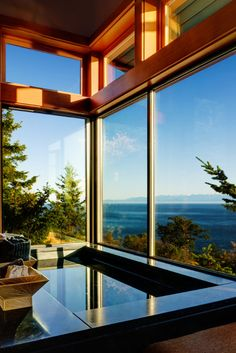 A beautiful bath for a beautiful house. A Contemporary House Overlooking The Coast of San Juan Island Design Exterior, Interior Exterior, Interior Architecture, Future House, My House, Marble Bath, Floor To Ceiling Windows, Big Windows, Corner Windows
