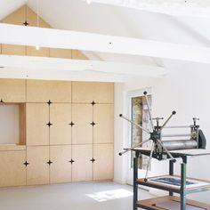 Parisian studio Modal Architecture has inserted a bright white artist's studio behind the thick schist walls of a 17th-century barn in Brittany