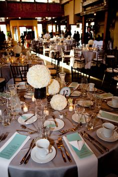 White and ivory floral wedding centerpieces with light blue and gray accent table setting, photo by La Vie Photography
