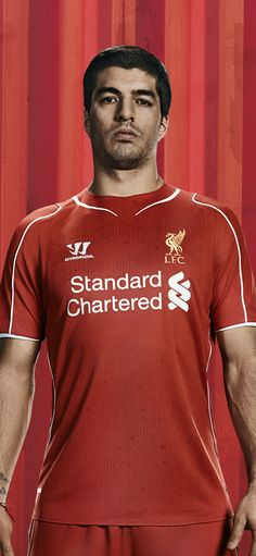 0998cd884 Liverpool s recently released Warrior home kit modeled by a thoroughly  bored Luis Suarez.