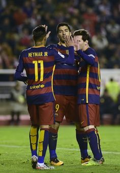 Barcelona's Argentinian forward Lionel Messi (R) celebrates after scoring with Barcelona's Uruguayan forward Luis Suarez (C) and Barcelona's Brazilian forward Neymar (L) during the Spanish league football match CF Rayo Vallecano vs FC Barcelona at the Vallecas stadium in Madrid on March 3, 2016.