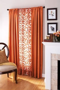 Patterned curtain in the middle of solid curtains. This is how I'm going to use those [super cheap on clearance!] red curtains I bought.