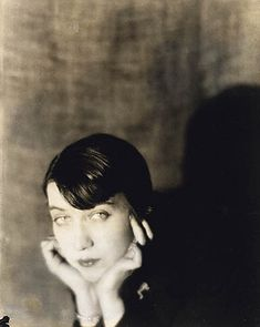 photographer Berenice Abbott (1898-1991) http://en.wikipedia.org/wiki/Berenice_Abbott  This picture was taken by Man Ray in Paris in 1921