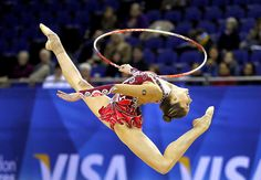Cynthia Valdez of Mexico performs with the hoop during the Rhythmic Gymnastics qualification for the London 2012 Olympic Games at North Greenwich Arena in London.