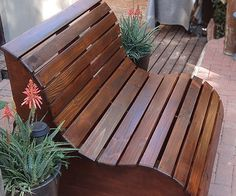 This slatted garden bench makes the perfect love seat for a garden. It's very easy to make. YOU WILL NEED:1 of 900 x 900mm 16mm marine plywood*7 of 20 x 94mm PAR pine - cut to 1040mm length12 of 20 x 69mm PAR pine - 3 cut to 1000mm length - 9 cut to 1040mm length5 x 50mm cut screwsWood glueWood filler (tinted for finished colour)Wood sealerMineral turpentineRagsTOOLS:Drill / Driver plus assorted bitsJigsaw and clean-cut bladeOrbital sander plus 60-, 120- and 240-grit sanding padsPain...