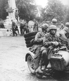 Fallshirmjager soldiers on a motorcycle operating near Normandy during 1944,