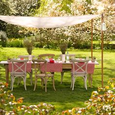 Alfresco dining area with canopy  This large extendingalfresco dining table and smart canopy provide the perfect spot for relaxed afternoon get-togethers. Placing the table in the centre of the garden, surrounded by blossoming trees, creates a central focal point.