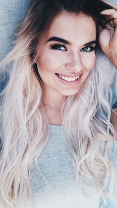 Platinum blonde hair with dark roots