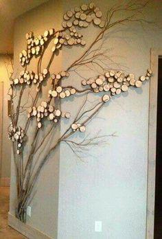 Wall art. Blowing tree twigs and wood circles