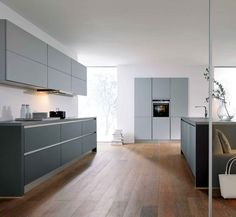 A lava black and stone grey kitchen. The grip ledges and plinth are in stone grey to complement the wall and tall units.