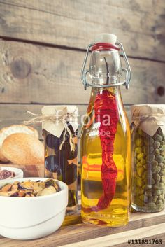 "Download the royalty-free photo ""Bottle of olive oil with chilli. Mussels and octopus in ceramic bowls, black olives and capers in jar, bran bread on black stone board. Mediterranean food."" created by Victoria Kondysenko at the lowest price on Fotolia.com. Browse our cheap image bank online to find the perfect stock photo for your marketing projects!"